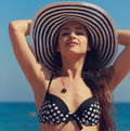 Sexy bikini woman in hat looking closeup happy on blue sea background portrait Stock Photography