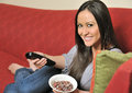 Sexy biracial woman eating almonds Stock Image