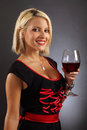 Sexy blond drinking red wine Royalty Free Stock Photography
