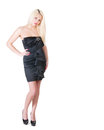 Sexy blond lady in black dress against white Royalty Free Stock Photo