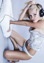 Sexy blond model Listens to music Royalty Free Stock Images