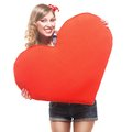 Sexy blond pin up girl with big heart in her hand isolated on white background Stock Photo