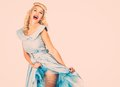 Sexy blond pin up style woman coquette young in blue dress Stock Photo