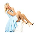 Sexy blond pin up style woman coquette young in blue dress Royalty Free Stock Image