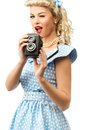 Sexy blond pin up woman coquette style young in blue dress with vintage camera Royalty Free Stock Photo