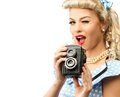 Sexy blond pin up woman coquette style young in blue dress with vintage camera Stock Images