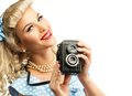 Sexy blond pin up woman coquette style young in blue dress with vintage camera Stock Photos