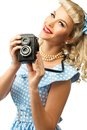 Sexy blond pin up woman coquette style young in blue dress with vintage camera Royalty Free Stock Image