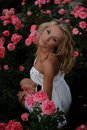 Sexy Blond In Pink Roses Royalty Free Stock Images