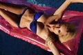 Sexy blond woman in blue bikini relaxing in swiming pool Royalty Free Stock Photo