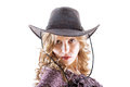 Sexy blond young lady in cowboy hat on white Royalty Free Stock Photography