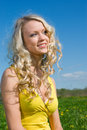 Sexy  blonde   on background of green meadow Royalty Free Stock Photo