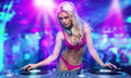 Sexy blonde dj girl Stock Photo
