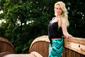 Sexy blonde fashion model on a bridge pretty woman girl with long hair standing Stock Photos