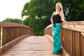 Sexy blonde fashion model on a bridge pretty woman girl with long hair standing Royalty Free Stock Photo