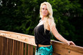 Sexy blonde fashion model on a bridge pretty woman girl with long hair standing Stock Photo