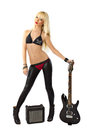 Sexy blonde girl with black electric guitar Royalty Free Stock Photo