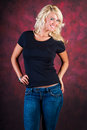 Sexy blonde girl fashion model in blue jeans Royalty Free Stock Photo