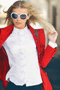 Sexy blonde girl posing outdoor wearing sunglasses Royalty Free Stock Photo