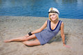 Sexy blonde girl in a sailor suit beautiful and lying on the sand Stock Image