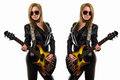 Sexy blonde girl in sunglasses black leather jacket playing guitar world music day two beautiful girls jackets play the mirroring Royalty Free Stock Photos