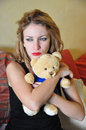Sexy blonde girl with teddy bear close up Royalty Free Stock Photos