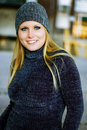 Sexy blonde girl in winter sweater hat beautiful and woman urban city streets wearing blue jeans grey and pull over beanie Stock Photos