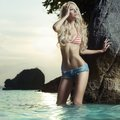 Sexy blonde at the sea beautiful slender summer travel photos Stock Image