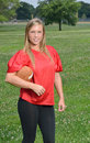 Sexy blonde woman American football player Royalty Free Stock Photo