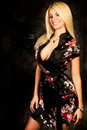 Sexy blonde woman fashion model in silk robe Royalty Free Stock Photo