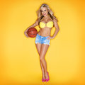 Blonde Woman Holding Basketball In Hand