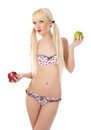 Sexy blonde woman in lingerie holding apples Stock Photos