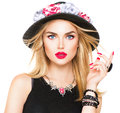 Sexy blonde woman with red lips and manicure in modern black hat Royalty Free Stock Photo