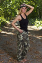Sexy blonde young woman in camouflage Stock Image