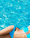 Sexy body of a young woman relaxing in a pool Royalty Free Stock Photo