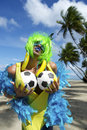 Sexy brazilian soccer fan on beach fondling her voluptuous footballs tropical Royalty Free Stock Images