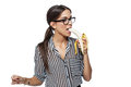Sexy brunette businesswoman in glasses eating banana isolated Stock Image