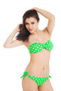 Sexy brunette girl wearing green swimsuit over white background Stock Image