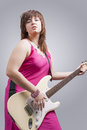 Sexy Brunette Lady Playing the Guitar Royalty Free Stock Photo