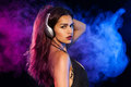 Sexy brunette listening music dj wearing headphones Royalty Free Stock Photo