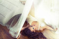Sexy brunette lying on the wooden floor Royalty Free Stock Photos