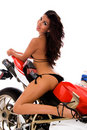 Sexy brunette on motorbike Royalty Free Stock Photography