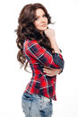Sexy brunette in a plaid shirt, isolated on white Royalty Free Stock Photo