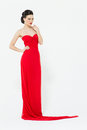 Sexy brunette in a slinky bright red evening dress Royalty Free Stock Photo