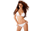 Sexy brunette with windblown hair in a bikini Stock Photos