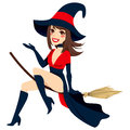 Sexy brunette witch flying on a broom isolated on white background Stock Photos