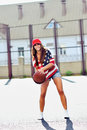 Sexy brunette woman playing basketball outdoor Royalty Free Stock Photo