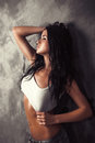 Sexy brunette woman posing with long wet hair studio shot photo Stock Images