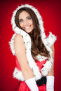 Sexy brunette woman in santa costume Royalty Free Stock Images