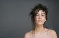 Sexy brunette woman with wet hair beauty on grey Royalty Free Stock Photo